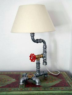 Industrial Pipe Dog Lamp created by Greek visual artist Metal Pipe, Plumbing Pipe, Iron Pipe, Metal Art, Pipe Desk, Pipe Lamp, Lamp Design, Diy Design, Desk Lamp