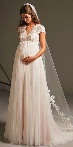 Being a pregnant bride is no excuse not to look chic and feel incredible. Our gallery including many different kinds of maternity wedding dresses. Wedding Dresses Pregnant Brides, Wedding Dress Shopping, Princess Wedding Dresses, Best Wedding Dresses, Boho Wedding Dress, Boho Dress, Lace Dress, Tulle Lace, Wedding Bride