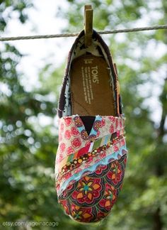 Cute redone TOMS. Working on doing this to a pair of mine that has holes