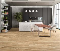 Mikeno Honey Wood Effect Wall And Floor Tiles - Mikeno from Tile Mountain Wood Effect Floor Tiles, Wall And Floor Tiles, Distinguish Between, Gold Wood, Reception Rooms, Wood Planks, Porcelain Tile, Kitchen Flooring, Natural Wood