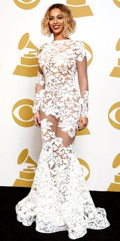 After dominating the stage, the singer set out to take over the red carpet in this sexy, white long-sleeve Michael Costello gown with strategically-placed sheer inserts and a plunging back. http://www.peoplestylewatch.com/people/stylewatch/package/gallery/0,,20768375_20780084,00.html#30091320