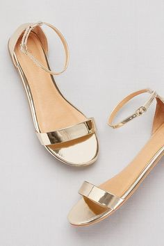 762b541aad0 Bright and shiny metallic ankle-wrap flats make the perfect festive sandal.