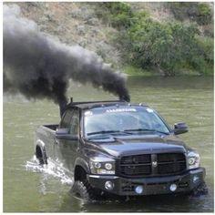 www.DieselTruckGallery.com black dodge ram cummins diesel rolling coal offroading
