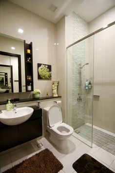 Simple and nice bathroom design. Love how the designer has used decor items  to liven