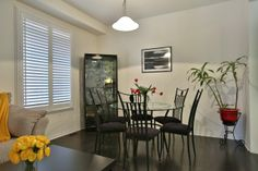 Gracious Dining Room ready for entertaining ... Dark Hardwood Floors & California Shutters. Thinking of Selling / Buying ... contact Susan 1st for her proven 7 Steps to Selling / Buying Successfully.   Susan@LancasterLuxuryHomes.com  www.LancasterLuxuryHomes.com