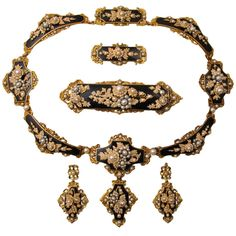 Georgian gold and pearl parure. A yellow gold, black enamel and natural pearl parure comprising a necklace, a pair of pendent earrings and two brooches. France, 1840. In its original fitted leather box. France. 1840.