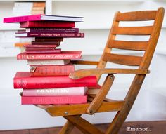 pink books on a chair
