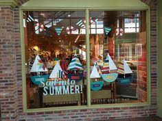 Im not saying we have to totally change the window/ideas we have rolling BUT i like the idea of how simple and clean it is AND also how the bunting and boats are all made with paper.