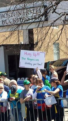 "One of my favorite 2014 Boston Marathon signs - ""Hurry Up - The Kenyans Are Drinking Your Beer!"" The 42 Best Signs From The Boston Marathon"