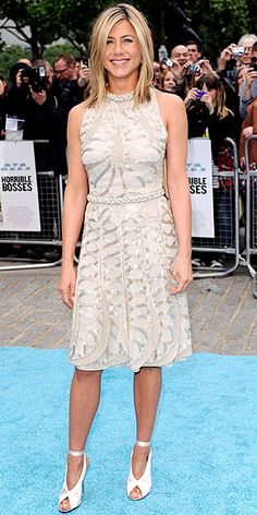 JENNIFER ANISTON The actress shines in a metallic beaded Valentino Haute Couture frock and ballet-pink peep-toes