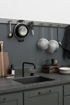 Dark kitchen inspiration, instead of tiles, a dark splash back with little hooks for displaying utensils