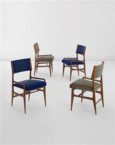 Walnut dining chairs by Gio Ponti.