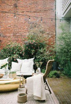 outdoor string lights over neutral patio decor / sfgirlbybay