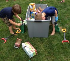 """Dumpster Diving"" for candy and prizes using their grabbers at the garbage truck themed birthday party. Boys loved this game!"