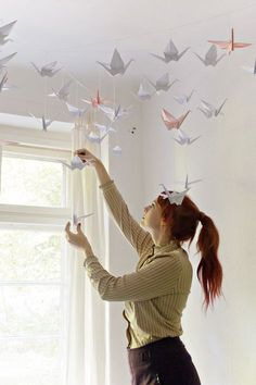 Create this renters friendly origami paper crane installation! Perfect for a kids bedroom or a sublet!