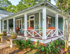 """Classic wrap around porch 5/4""""x6"""" Cumaru decking with hidden fasteners finished with Ipe' (tung) oil."""