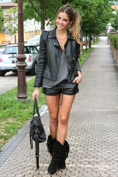 Black leather biker jacket and shorts, grey tshirt, awesome suede fringe boots...