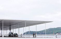 The Naoshima Ferry Terminal is set on a small island in the Inland Sea of Japan. The terminal area is sheltered by a large roof measuring approximately square feet. Ryue Nishizawa, Steel Canopy, Garden Canopy, Information Center, Brick And Stone, Roof Design, Small Island, Interior Architecture, Exterior
