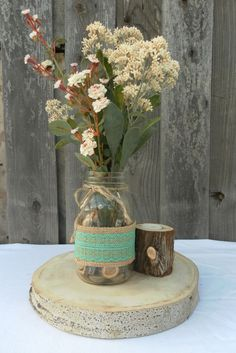 This lovely burlap and lace ribbon can be used in so many ways- wrapped around mason jars, candles and cake stands, used to create bouquets and boutineers, added to table runners and tied into bows- it will add a rustic elegance to your wedding decor.