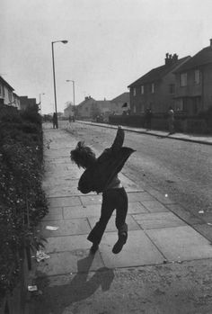 "firsttimeuser: "" Boy throwing stones at British soldiers in Northern Ireland, 1971 photo by Gilles Peress "" Gilles Caron, Northern Ireland Troubles, Northern Irish, Photo Vintage, Vintage Style, Night Pictures, British Soldier, Beautiful Castles, Victor Hugo"