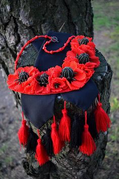 A personal favorite from my Etsy shop https://www.etsy.com/listing/516231655/beaded-red-poppy-flower-necklace-beaded