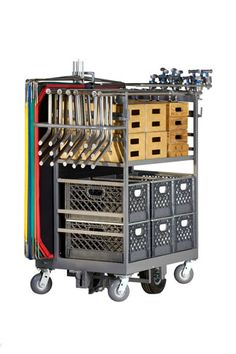 "Studio Easy Duz-All Cart Model EDA-101 $1,475.00 • (1) Adjustable Shelf (L41.75"" x W20"") • (1) Stationary Shelf (L41.75"" x W20.25"") • Aluminum Diamond Plate Backing ""Divider"" • (2) Telescopic Pullout Holders • Safety Push Handle • 4'x 4' Flag Space w/Adjustable Holder, Holds (8) Floppies • Foot Brake with Anti-skid Plate • Wheels (2) 10"" Centered Pneumatic and (4) 6""Swivel Casters • Optional (2) Foam Filled Wheels $80.00 L55"" x W29"" x H61.75"" 196 lbs."