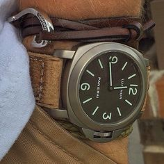 A base dial is a thing of beauty. It's even nicer in Titanium with a Tobacco dial like this paired with the leather hook bracelet. Panerai Watches, Panerai Luminor, Sport Watches, Luxury Watches, Cool Watches, Watches For Men, Hook Bracelet, Vintage Watches, Men Accessories
