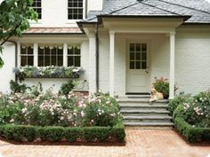 Love the house color, copper roof, boxwood-lined beds, roses, and flower box The use of different roofing materials add to the appeal of the house Garden Front Of House, House Front, Exterior Colors, Exterior Paint, Copper Roof, Outdoor Living, Outdoor Decor, Outdoor Spaces, Outdoor Ideas