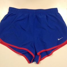 NWT Blue, Red, and White Nike Tempo Shorts NWT Nike Red, white, and blue XS Tempo Shorts Bright red inside that includes a draw string the sides are remand white stripes would be perfect for the 4th of July Always open to offers (: Nike Shorts