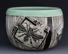 Sgraffito - This style is accomplished by applying a layer over another layer of paint (underglaze usually) and then scratching through the first layer exposing the color of the second creating a design or pattern. It can also be done by layering a thin outside layer of colored slip, then sgraffitoing through that.
