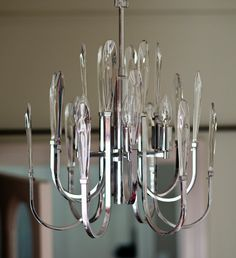A Chrome and glass Gaetano Sciolari chandelier. Fully working with all parts. See Pictures. high by 38 cm wide Will advise shipping costs once packaged. I only charge shipping and packaging costs. See Picture, Chrome, Chandelier, Ceiling Lights, Lighting, Glass, Pictures, Etsy, Home Decor