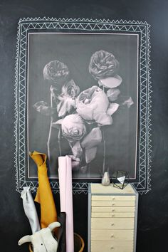 A composition of delicately wilting roses, printed in greyscale on color paper. The color of the paper lends a glowing quality to the flowers. Debbie Carlos' printing technique lends a rough and textural aesthetic to the image. www.mooreaseal.com
