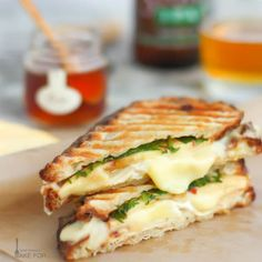 Chicken, brie and apple panini sandwich, sweetened with a drizzle of honey.