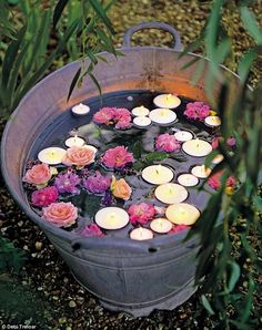Filling an old bathtub, metal bucket or ceramic butler's sink with water, floating candles and flower heads is a sweet and inexpensive lighting feature for parties or evening gatherings in the garden. You could also try this idea on a smaller scale by filling jam jars with water and floating a candle and a few daisies in each one.