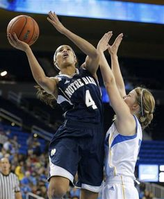 In this Nov. 23, 2012 file photo, Notre Dame guard Skylar Diggins, left, puts up a shot against UCLA guard Kari Korver during the first half of an NCAA womens college basketball game in Los Angeles. Diggins was selected to the 2012-13 AP WomensAll-America team, Tuesday, April 2, 2013
