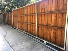 Pre-sealed cedar board on board slide gate with cap and trim. Installed by Titan Fence & Supply Company. Cedar Boards, Cedar Fence, Fence Ideas, Gates, Building, Outdoor Decor, Cap, Posts, Metal
