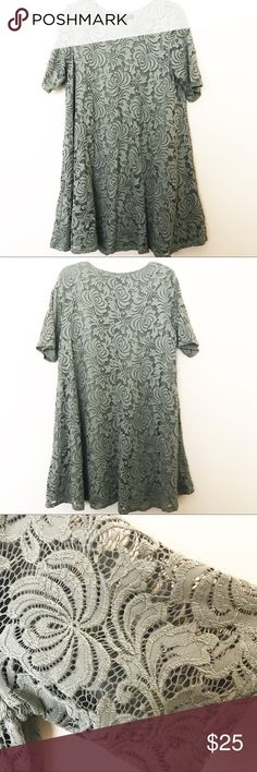 Olive Green Tunic Dress with Floral Lace This dress is flirty and lots of fun! It flairs out at the bottom and features a beautiful floral lace. It's gently worn and is perfect for any special occasion. Dresses
