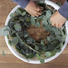 DIY Wreath hack alert! Head to your local dollar store to pick up an inexpensive plastic laundry basket to make this handmade Christmas wreath. They're the perfect size and shape for weaving eucalyptus branches into a wreath. (You can also you can upcycle an old or broken round laundry basket.) #diywreath #wreathhack #howtomakeawreath #christmaswreath #dollarstorewreath #bhg Diy Wreath, Wreath Crafts, Decor Crafts, Fun Crafts, Diy Home Decor, Arts And Crafts, Eucalyptus Branches, Eucalyptus Wreath, Christmas Wreaths