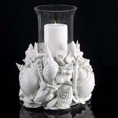 Make your own candle centerpiece for your beach wedding.  This centerpiece…