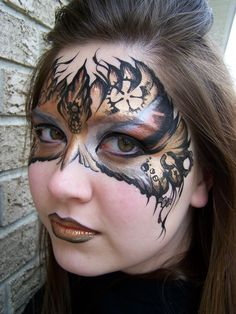 Steampunk mask face painting. I need to get me some face paint!