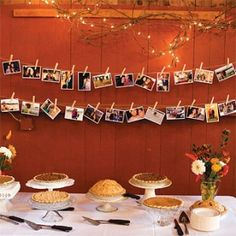 pie table with hanging photos, would be great for the playroom too, minus the pies:)