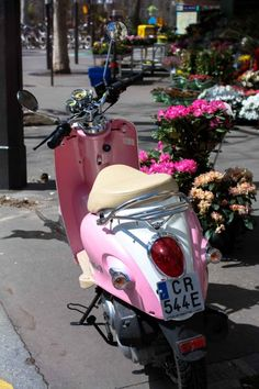 pink vespa on the streets of paris