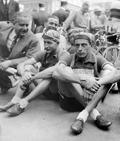 Picture taken in July 1949 of Italian cyclists Gino Bartali (L) and Fausto Coppi (R) waiting before the start of a stage of the Tour de France. The two champions won 2 Tour de France each : Bartali in 1938 and 1948, Coppi in 1949 and 1952.