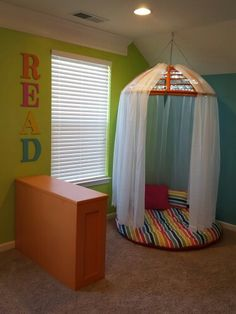Reading nook made with an old papasan chair/cushion.  Added some rope lights for extra fun!