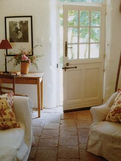 So cozy! Love the door, the comfy furniture, the stone floor, the little desk - everything.