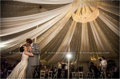 Awesome shot of this couple's first dance inside their beautiful reception tent.
