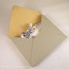 Kim Duran's tutorial on how to make an envelope for mailing lumpy cards.  this envelope will require two first-class postage stamps due to the thickness of the envelope.
