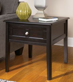 """Henning by Ashley  Cocktail table and two end tables  Made from select veneers and hardwood solids, Almost black painted finish, Paneled sides and drawer fronts, Dovetailed drawers with ball bearing side glides, Brushed nickel color knobs,  3pc Set $599.00     Cocktail: 50""""W 28""""D 20""""H  End: 24""""W 27""""D 24""""H   OAK T479Set"""