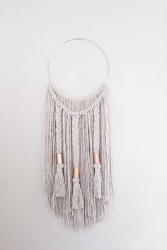 DESCRIPTION - This dreamy brass ring macrame wall hanging is made with natural white cotton cord and copper beads. It is a two layered piece