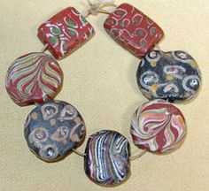 Rare antique Venetian made fancy lampwork beads with trail decoration collected from Africa. Sometimes these beads are referred to as 'Trade Beads'.
